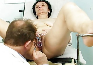 old brunette granny gets her old twat examined by