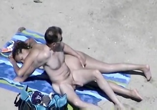 sexually slutty wife with large pantoons on beach